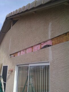 Stucco removed for ledger